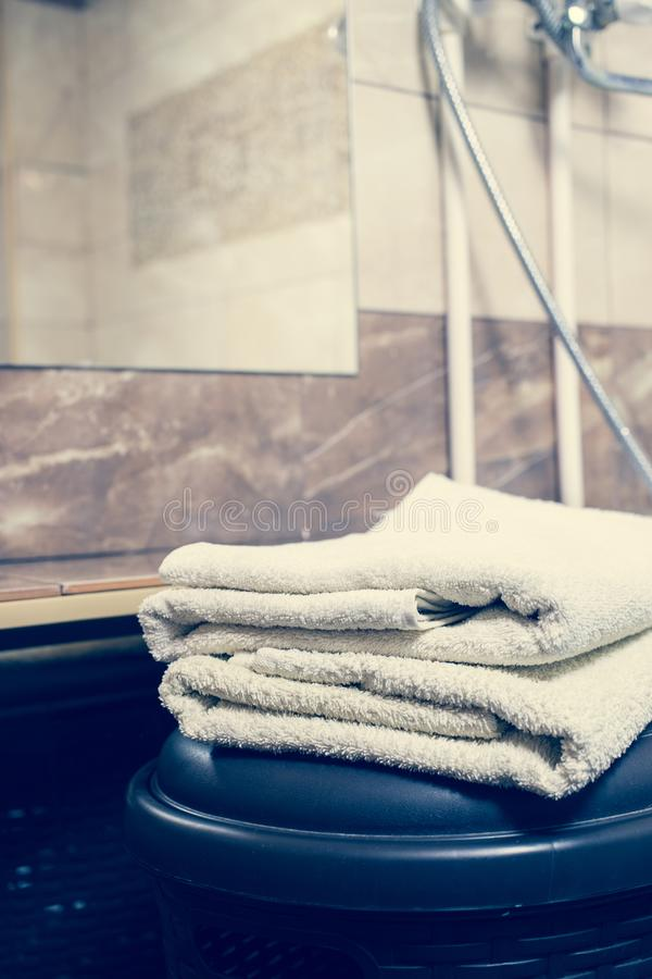 Blurred bathroom interior background and white spa towels on Marble stock image