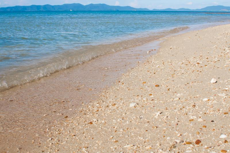 Blurred beach with crushed sea shells at the sea stock photo