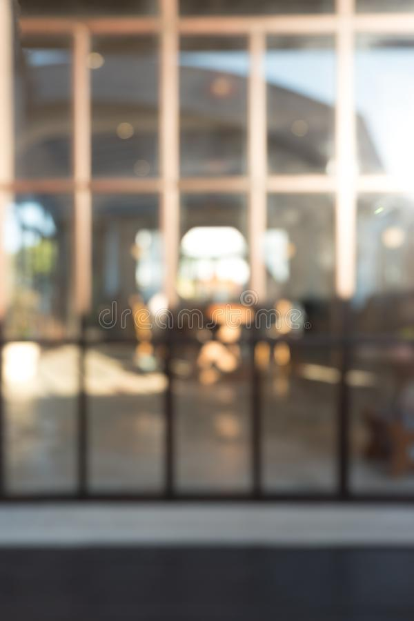 Blurred big window interior restaurant cafe with sunlight in vintage style. Abstract blur background stock image