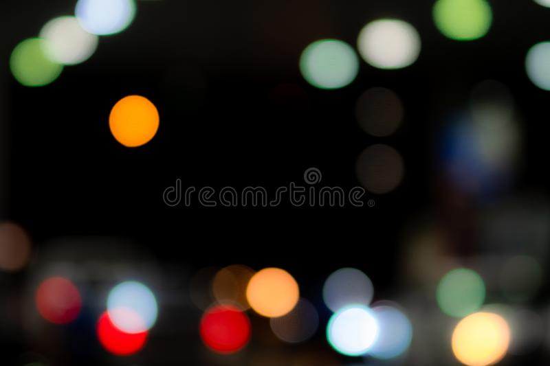 Blurred blue, orange, green, red, and white bokeh  abstract background. Blur bokeh on dark background. City light in the night. royalty free stock image