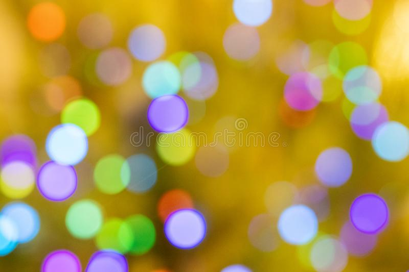 Blurred bokeh, background with bright colored lights of Christmas and happy New year. Blurred bokeh. background with bright colored lights of Christmas and happy stock photos