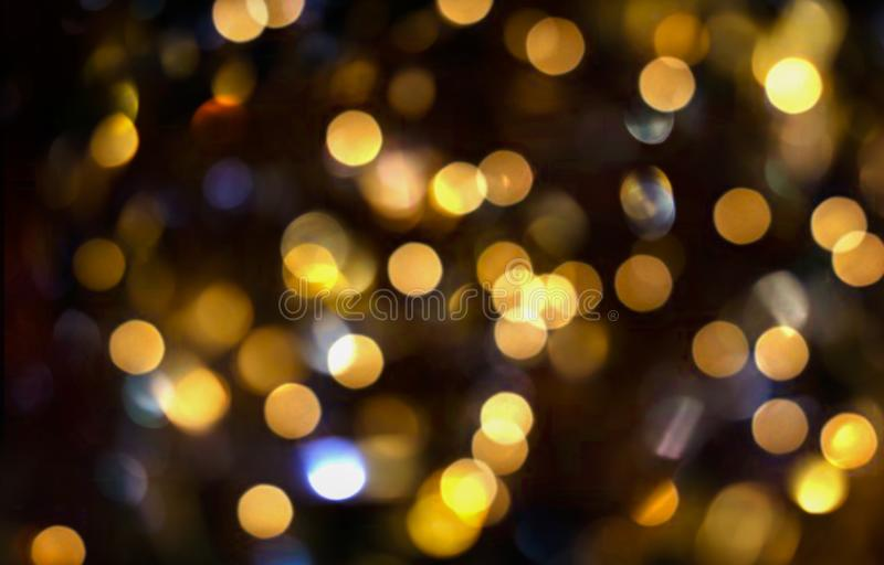 Blurred bokeh background, light effect, glitter, flaming lights, holiday, yellow circles on black, Christmas, fun. Abstract background spot blurred blurred bokeh royalty free illustration
