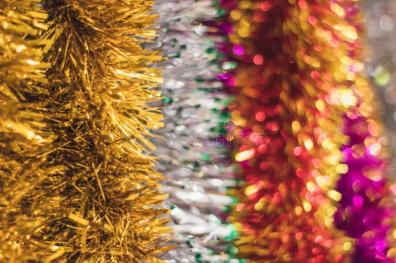 Blurred bokeh background with New Year`s colorful tinsel. Christmas concept. Place for text. Happy New Year royalty free stock photo