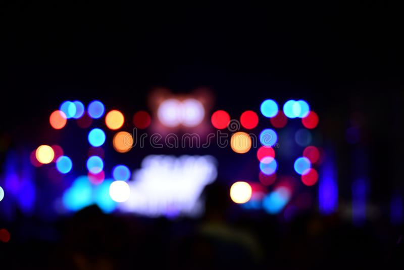 Blurred bokeh in the concert stage on New Year`s Day. NBlurred images of colored lights on the night of the New Year`s Stars royalty free stock images