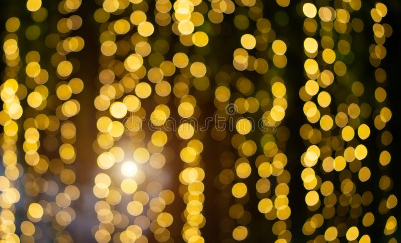 Blurred Bokeh Glitter Christmas, Xmas Holiday. Golden Abstract Blurred Bokeh Glitter Christmas, Xmas Holiday stock photography