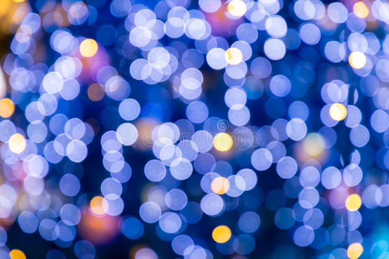 Blurred bokeh light background, Christmas and New Year holidays background. Colorful beautiful blurred bokeh background with copy royalty free stock photography