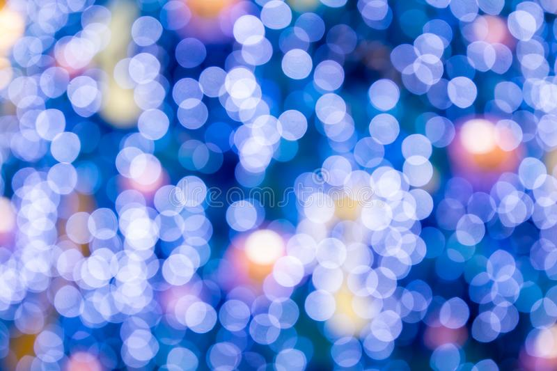 Blurred bokeh light background, Christmas and New Year holidays background. Colorful beautiful blurred bokeh background with copy. Space. Holiday texture royalty free stock image