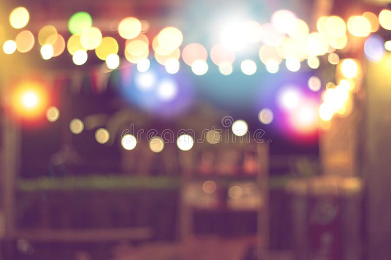 Blurred bokeh night lights in restaurant, abstract image of night festival, background party blur celebration concept stock photo