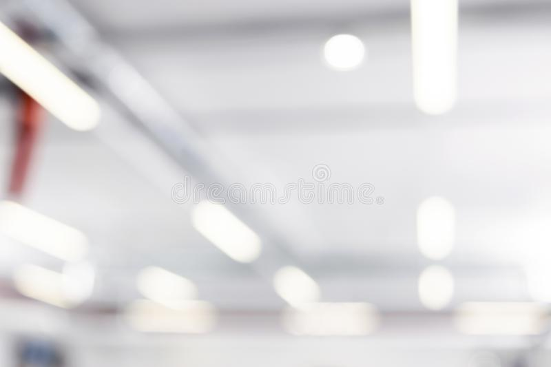 Blurred business background. Blur warehouse with bokeh light background. Blurred background Lights and ventilation system in long royalty free stock photos