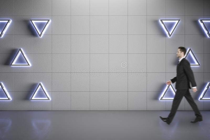 Blurred businessman walking on concrete floor royalty free stock photography