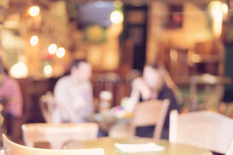 Blurred cafe - retro effect style photo. Blurred cafe with customers, retro effect style photo royalty free stock images