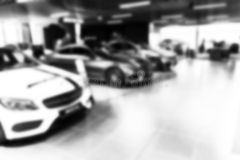 Blurred car dealership store bokeh background, Cars soft lightning, Blur bokeh transportation concept dealer showroom background. Blurred car dealership store stock photos