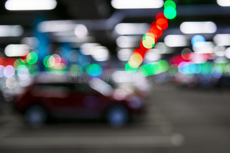 Blurred cars in car parking lot in shopping mall. Bokeh lights background. Abstract blur car parking lot for background. Blurred c stock photos
