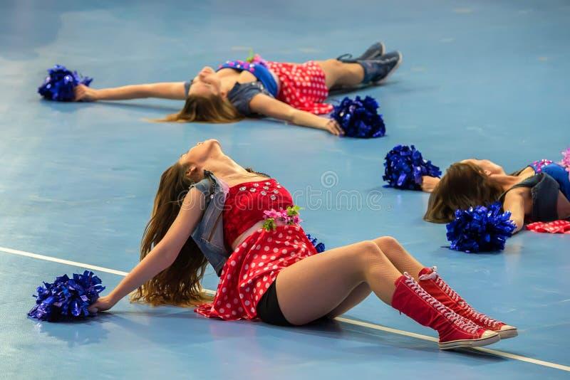 Blurred cheerleaders entertaining audience stock images