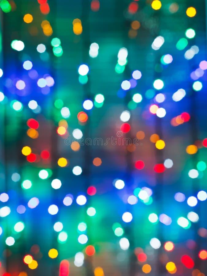 Blurred christmas illumination on window royalty free stock photos