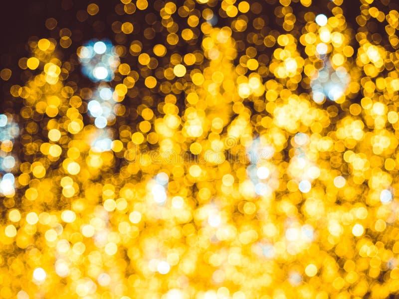 Blurred Christmas lighting backdrop. Bright Christmas Street Illumination on the facade of the buildings. Burning. Lanterns on Nikolskaya street in Moscow. The royalty free stock photo