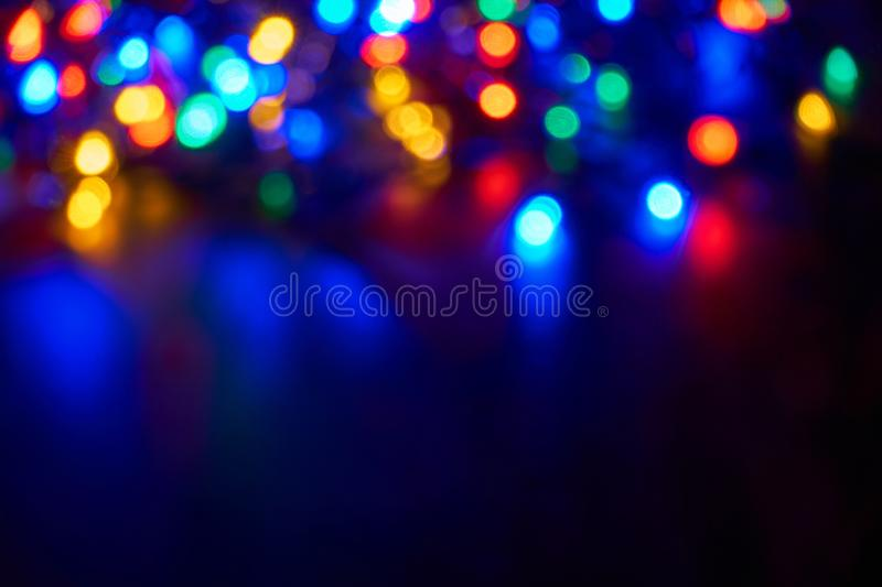 Blurred christmas lights on dark background stock photo