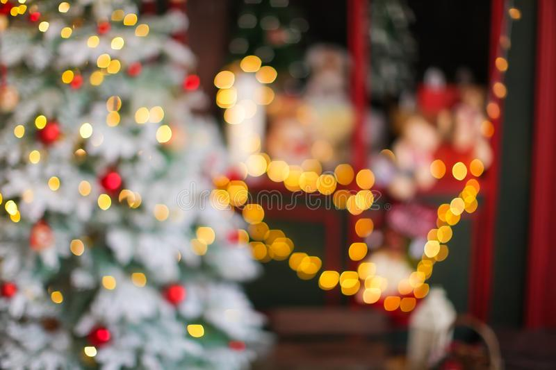 Blurred christmas and new year background with bokeh royalty free stock photography