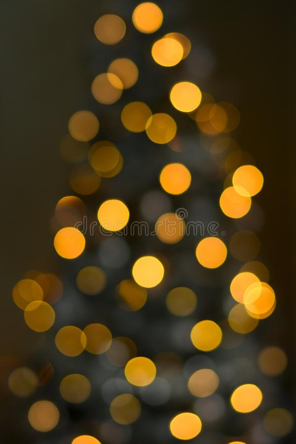 Blurred Christmas tree background with blurry bokeh lights. Defocused blurred Christmas tree background with blurry bokeh lights stock image