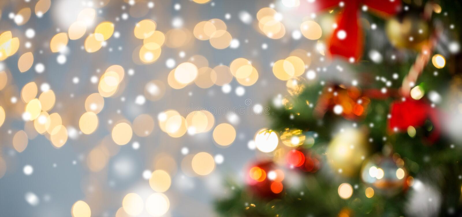 Blurred christmas tree decorated with balls royalty free stock photos