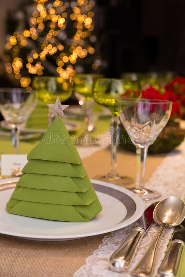 Blurred christmas tree and dinner table royalty free stock photo