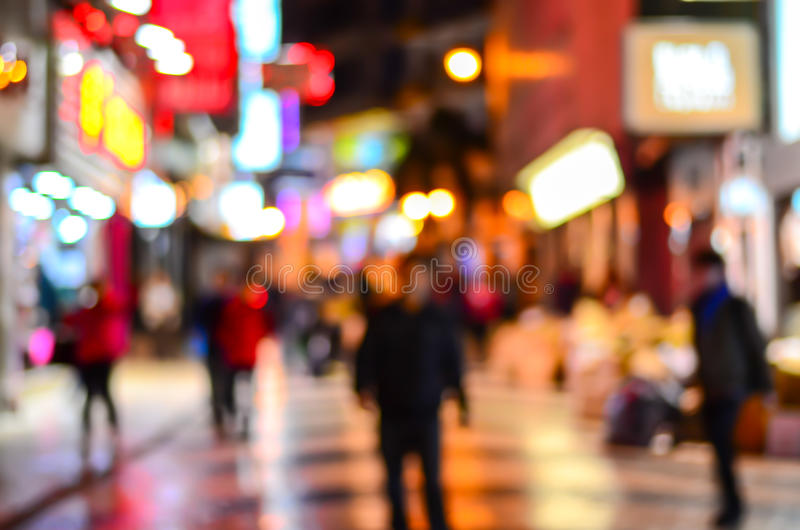 Blurred city shopping and people urban scene. At night royalty free stock photography
