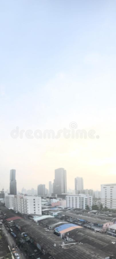 Blurred city urban for banner advertising background, building and city home landscape background soft and sunset light on sky royalty free stock images