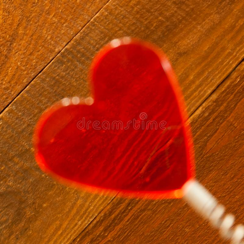 Blurred Clear Red Heart On Coil Spring. Rustic Wooden Background. Angled View. Saint Valentines Day, Love Card, Banner, Message. Concept stock photography