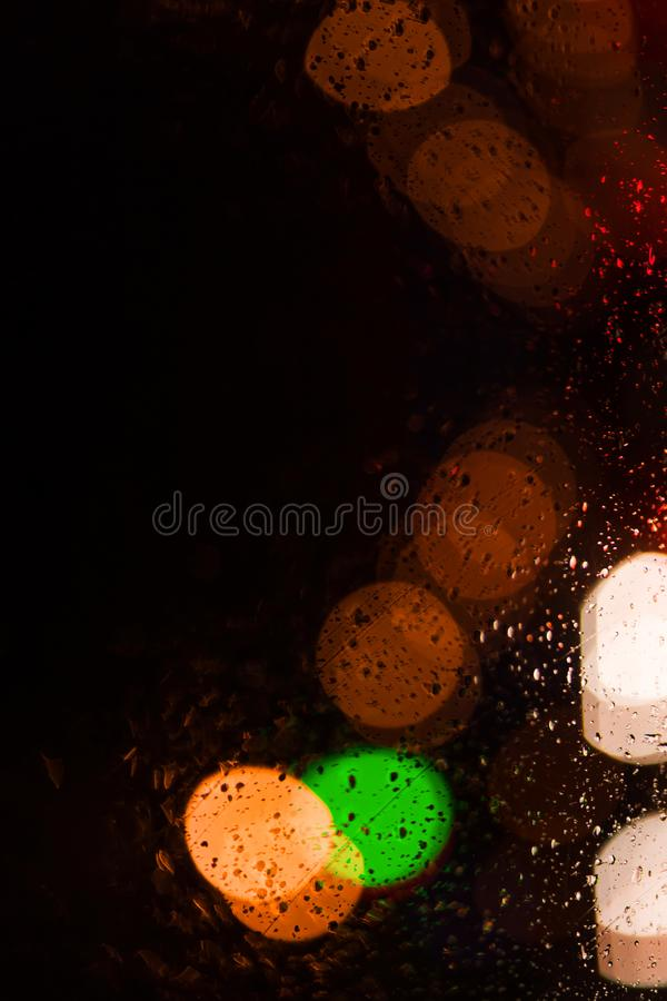 Blurred colorful circles bokeh on black background royalty free stock images