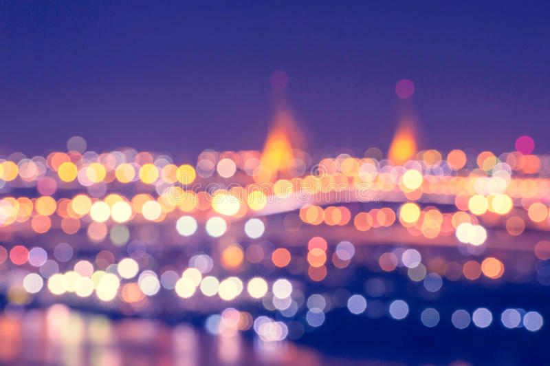 Blurred colorful light and booked of the bridge and City. Blurred colorful light, bokeh of the bridge and city at the Chao Phaya Riverside of Bangkok City stock image