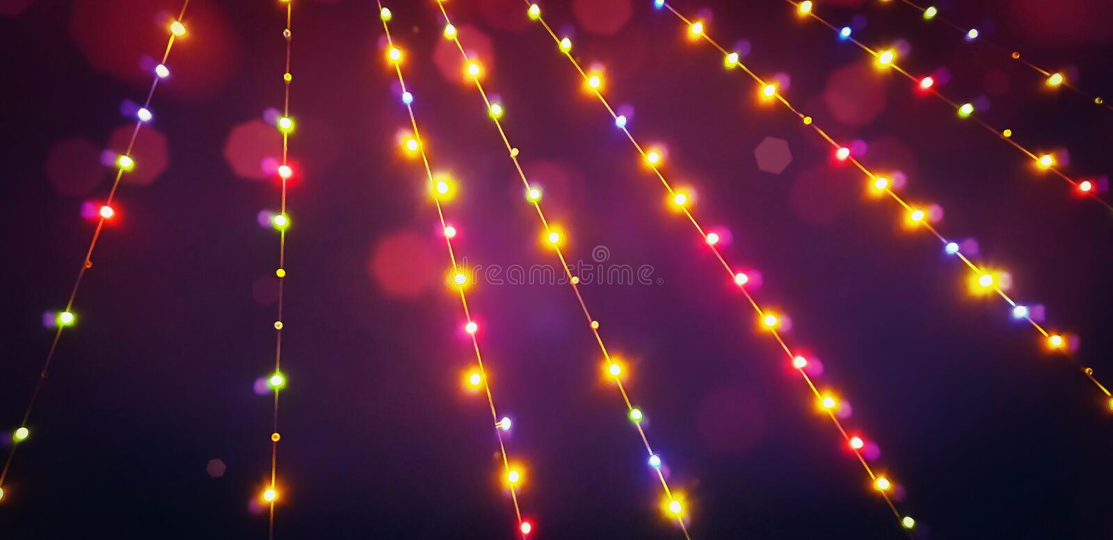 Blurred summer party outdoor bulb garlands. Blurred colorful summer party outdoor bulb garlands stock photo