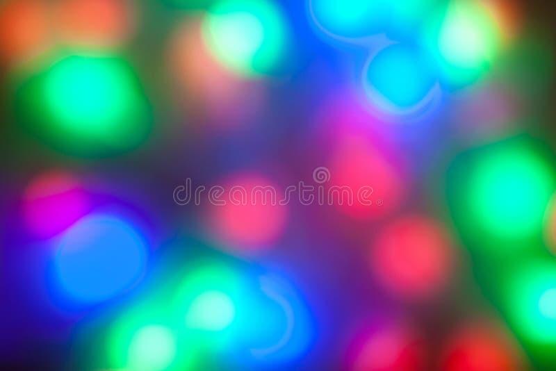 Blurred coloriu festões das luzes foto de stock