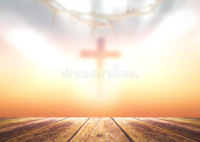 Good Friday and Easter Sunday concept. Wooden floor with blurred cross and sunset amazing light background royalty free stock photos