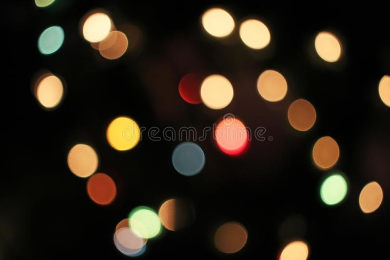 Blurred defocused christmas light lights bokeh background. Colorful red yellow blue green de focused glittering pattern royalty free stock photos