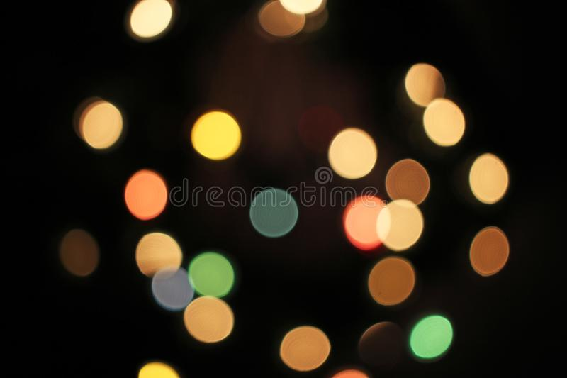Blurred defocused christmas light lights bokeh background. Colorful red yellow blue green de focused glittering pattern stock images