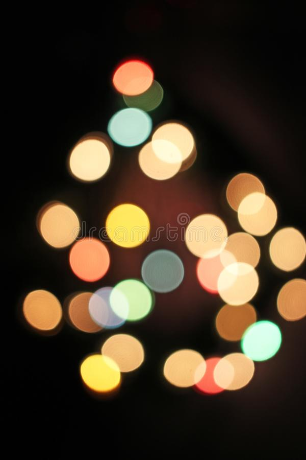 Blurred defocused christmas light lights bokeh background. Colorful red yellow blue green de focused glittering pattern stock photography