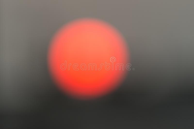 Blurred And Defocused Image Of The Sun At Dawn In The City, Abstract Background With Copy Space stock photo