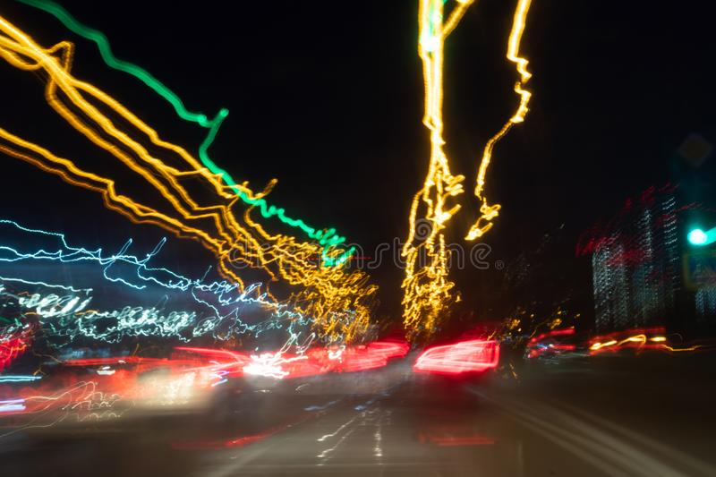 Blurred Defocused Lights of Heavy Traffic on a Wet Rainy. traffic lights in motion blur stock photos
