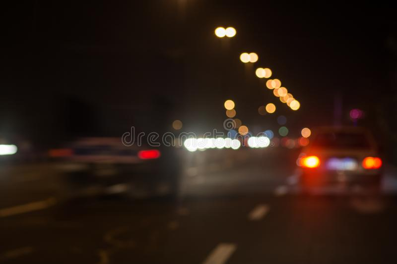 Blurred defocused lights of traffic in the city royalty free stock photos