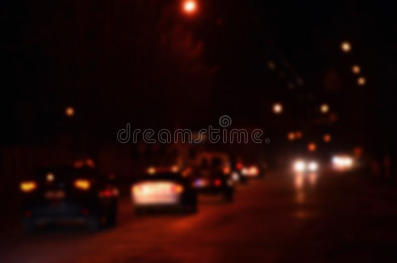 Blurred Defocused Lights of Traffic on a Wet Rainy City Road at Night - Commuting at Rush Hour Concept Abstract bokeh from car li. Blurred Defocused Lights of royalty free stock photo