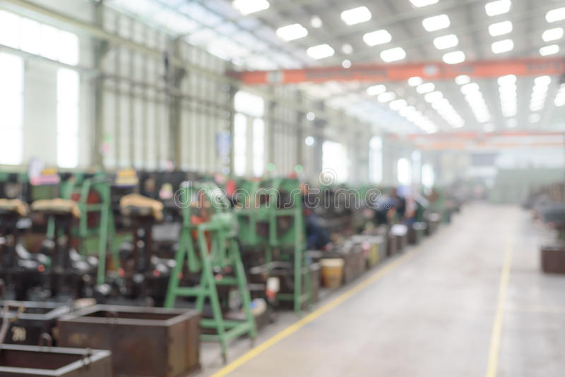 Blurred or defocused machines inside manufacturing factory royalty free stock photo