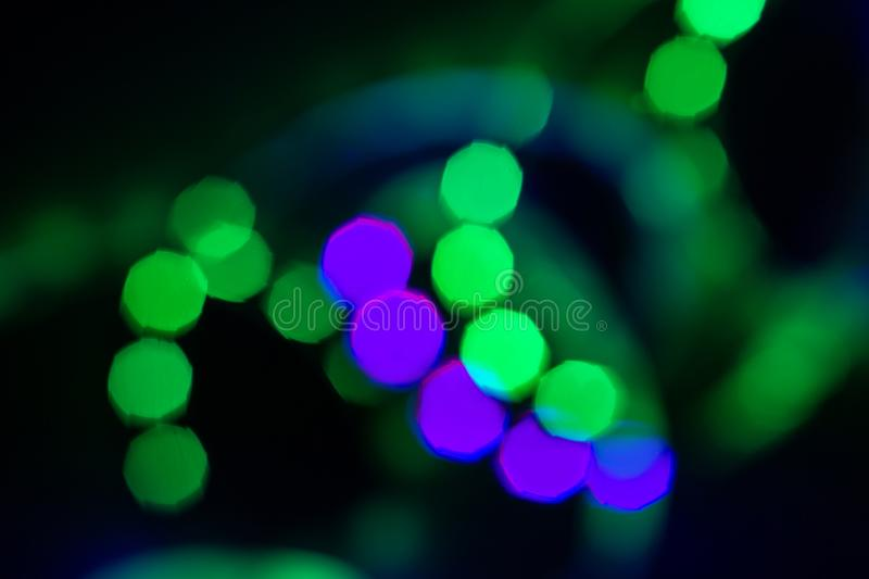 Blurred duotone bokeh lights spiral on black. Abstract background for your design royalty free stock image