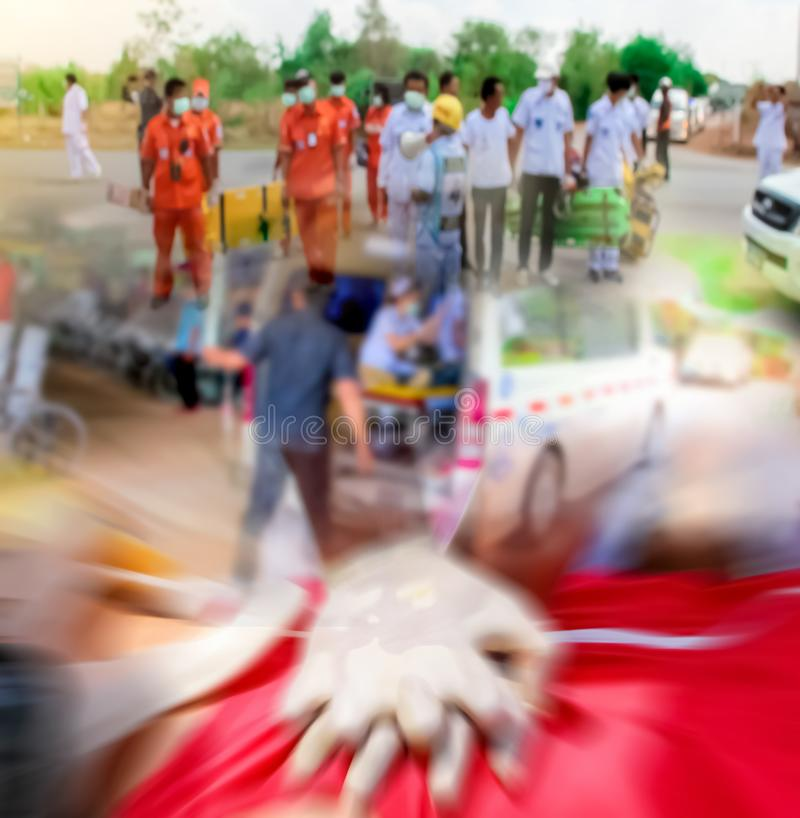 Blurred of emergency medical staff team. Blurred of emergency medical staff team transporting patient to hospital with ambulance into an Accident & Emergency stock photo