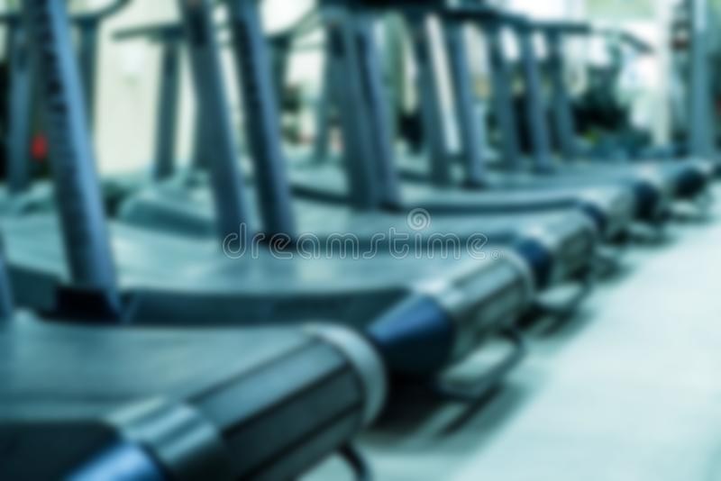 Blurred empty treadmills set in gym interior close stock photo