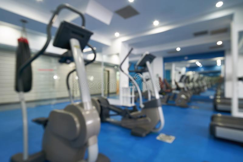 Blurred fitness and gym interior with sport equipment for backgr. Ound royalty free stock images