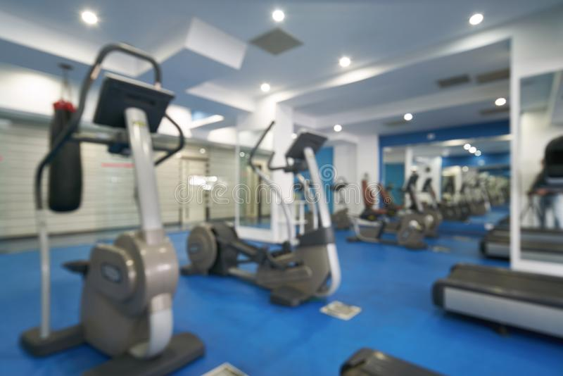 Blurred fitness and gym interior with sport equipment for backgr. Ound royalty free stock photos