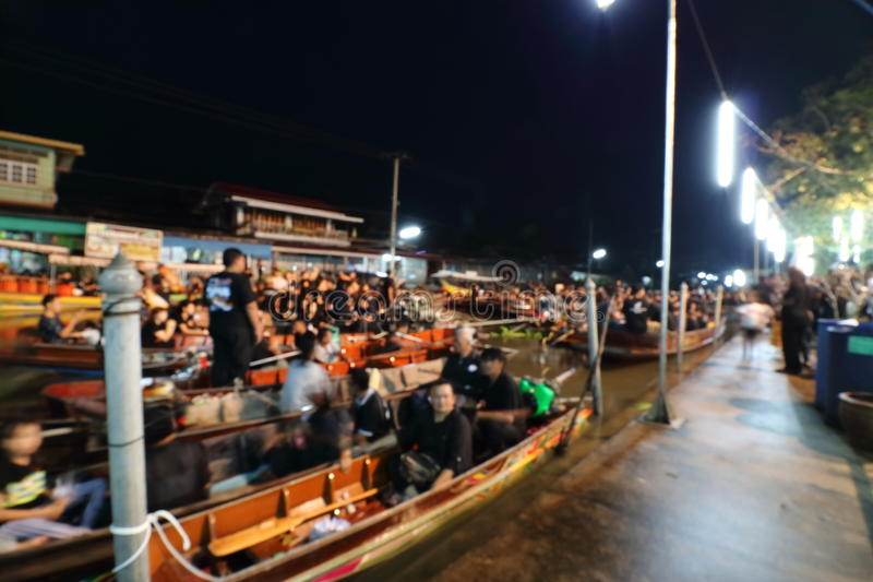 Blurred focus of Thai people waiting sing the anthem and hold the candles on the boat pray for his Majesty King Bhumibol Adulyadej royalty free stock photo