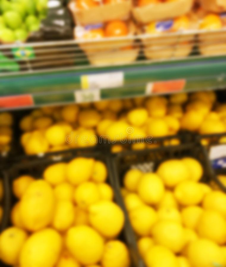 Blurred fresh fruits and vegetables at retail store. Abstract background of supermarket. Grocery market blurred background. Fruits. In store racks. Interior royalty free stock photos