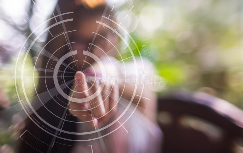 A blurred girl pointing finger on a technology touch screen stock photography