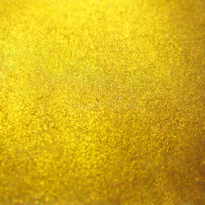Blurred gold golden metal glitter surface background texture.  royalty free stock photo
